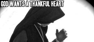 Nun deep in prayer by Robert Frank Gabriel on flickr 950x425-text